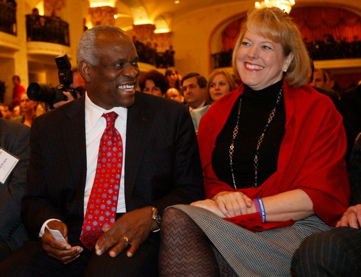 Supreme Court Justice Clarence Thomas sits with his wife Virginia Thomas in November 2007 as he is introduced at the Federali