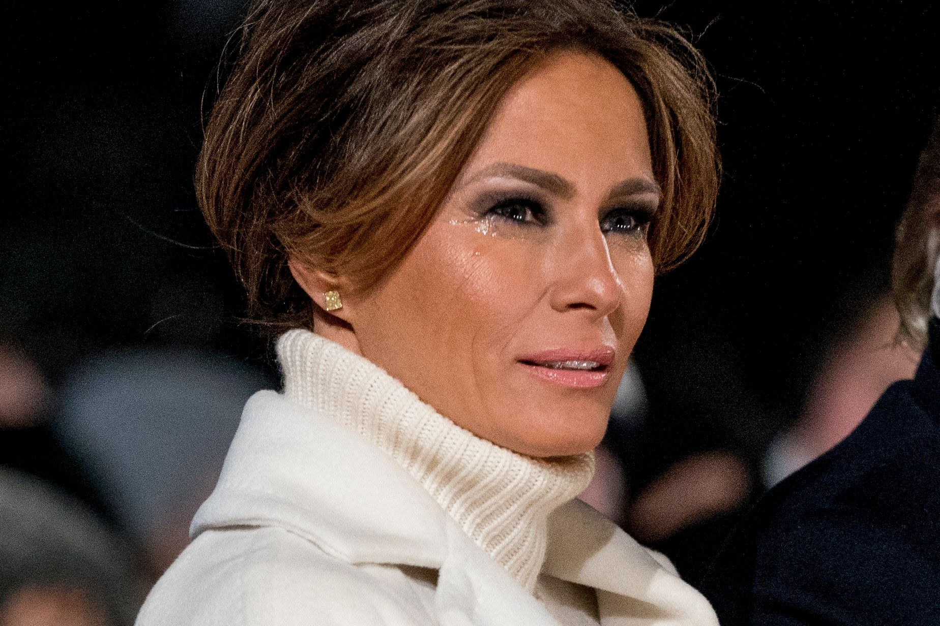 Tears collect on the face of first lady Melania Trump in the cold during the National Christmas Tree lighting ceremony at the Ellipse near the White House in Washington, Wednesday, Nov. 28, 2018. (AP Photo/Andrew Harnik)