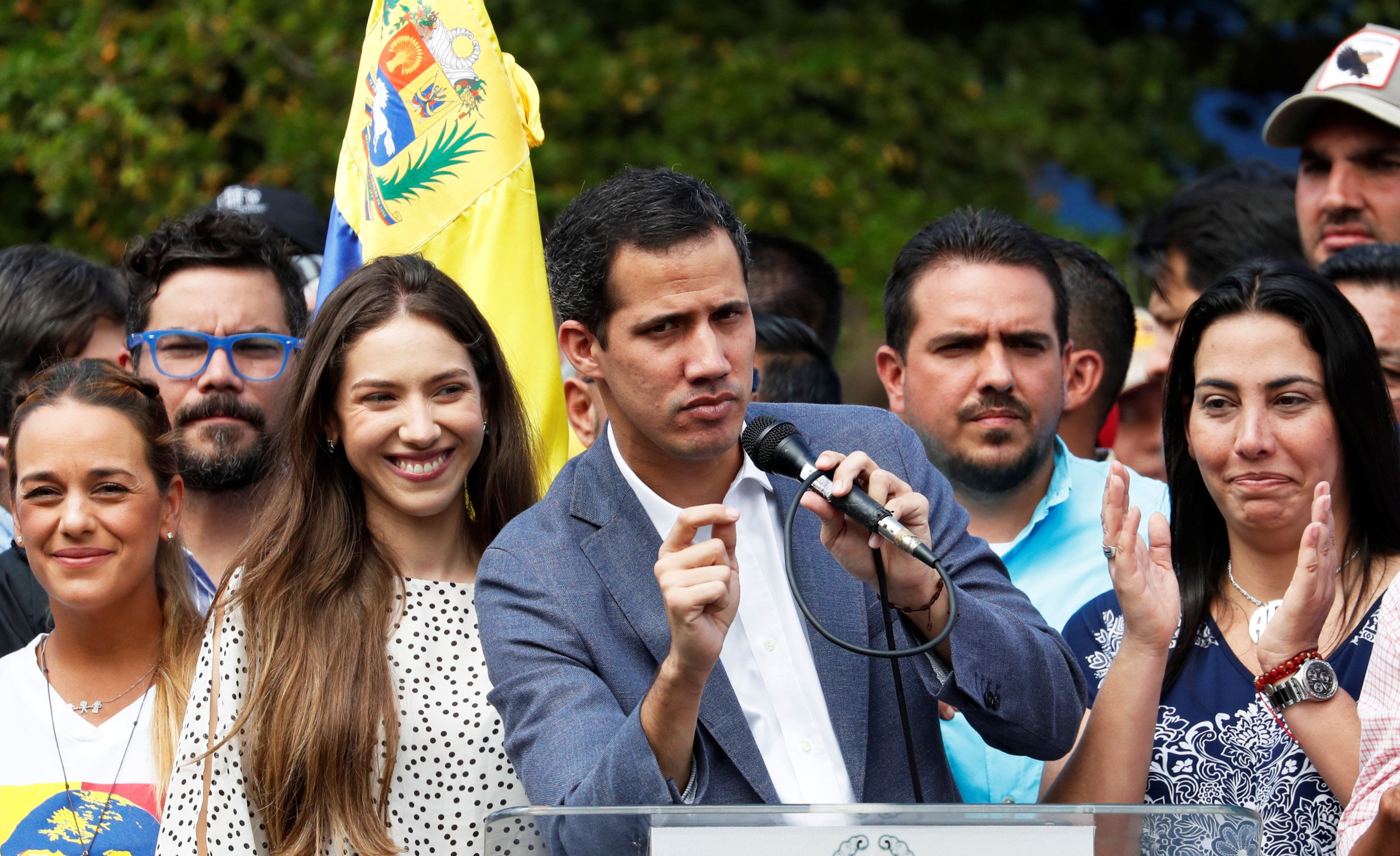 Venezuela's opposition leader Juan Guaido speaks during a rally with members of the Venezuela's National Assembly regarding an amnesty law project for members of the military, in Caracas, Venezuela, January 26, 2019. REUTERS/Carlos Garcia Rawlins