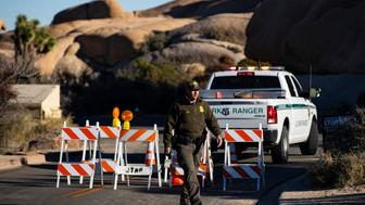 JOSHUA TREE, CA - JANUARY 8:  Park Ranger Dylan Moe closes off the access road to Jumbo Rocks campground at Joshua Tree National Park on January 2, 2019 in Joshua Tree, California. All the campgrounds were closed at noon on Wednesday due to the government shutdown.   (Photo by Gina Ferazzi/Los AngelesTimes via Getty Images)