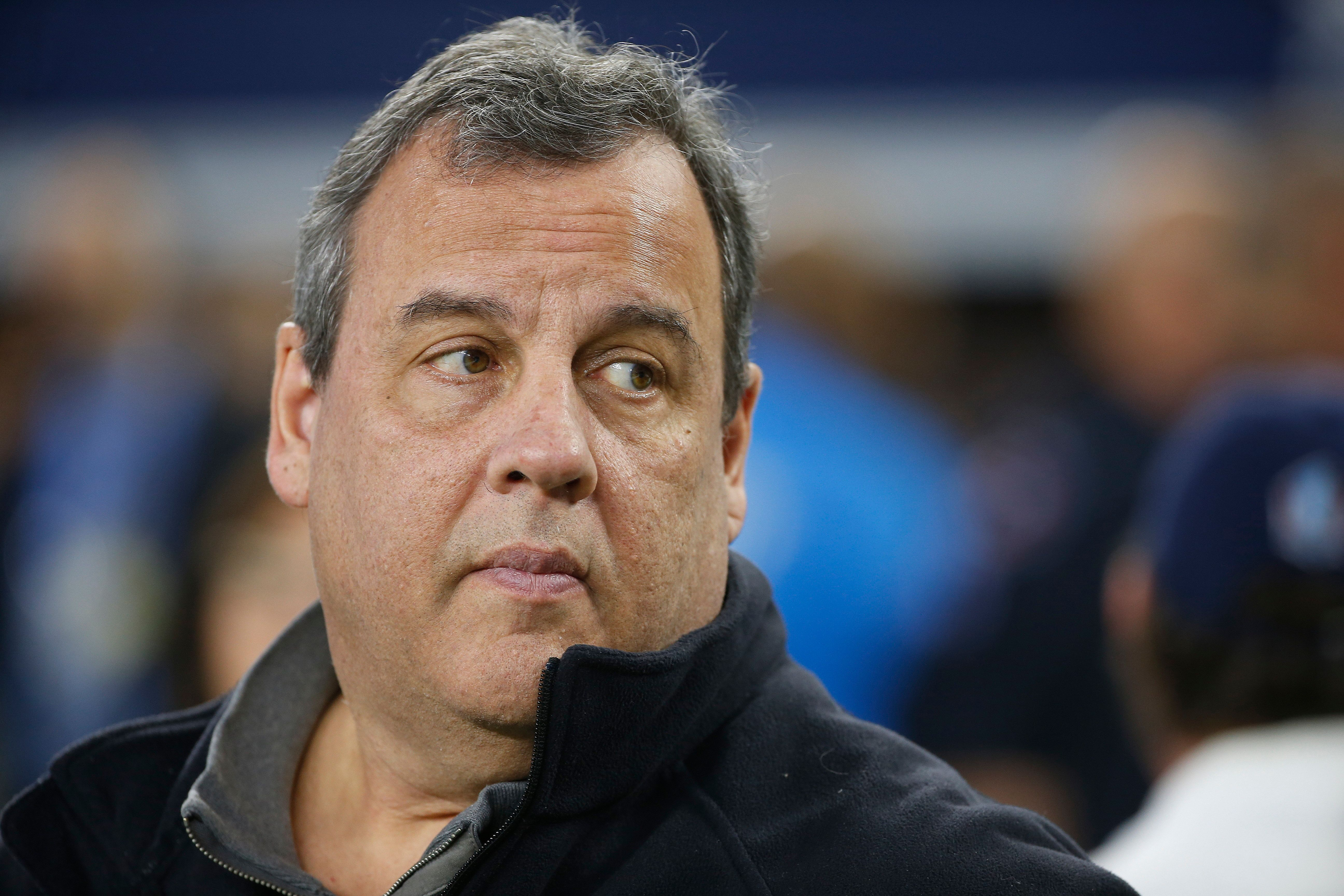 Former New Jersey Gov. Chris Christie walks on the field before a NFC wild-card NFL football game, between the Dallas Cowboys and the Seattle Seahawks in Arlington, Texas, Saturday, Jan. 5, 2019. (AP Photo/Ron Jenkins)