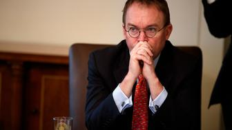 "FILE- In this Jan. 2, 2019, file photo White House chief of staff Mick Mulvaney listens as President Donald Trump speaks during a cabinet meeting at the White House in Washington. Mulvaney says Trump is prepared for another government shutdown if Congress won't work with him to secure the southern border. Mulvaney spoke Sunday, Jan. 27, on CBS' ""Face the Nation"" and ""Fox News Sunday."" (AP Photo/Evan Vucci, File)"