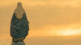 Virgin mary statue warm tone sunset scene