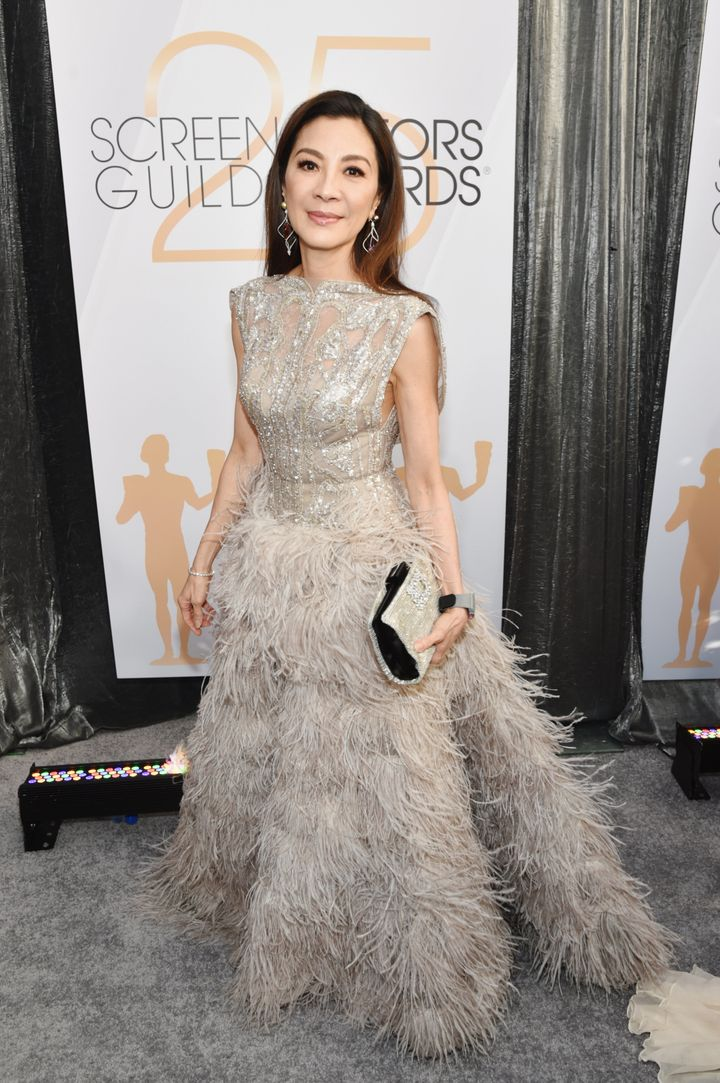 Yeoh in a silver feathered gown.