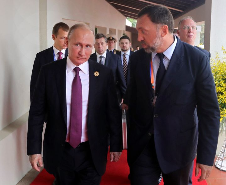 Russia's President Vladimir Putin, left, and Russian metals magnate Oleg Deripaska, exact, stroll to abet the APEC Industrial A