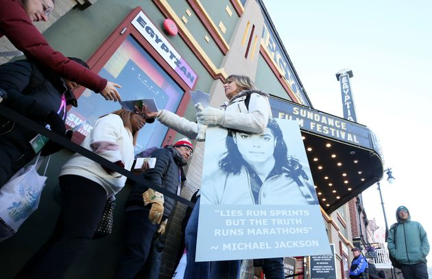 A protester hands out pamphlets to attendees at the documentary's premiere Friday at the Sundance Film