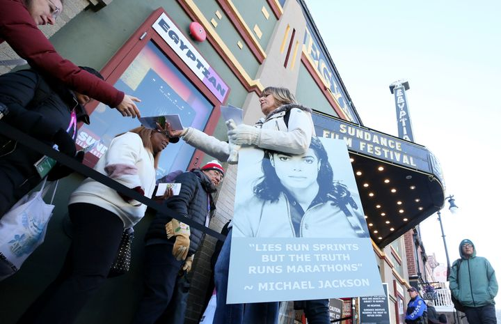 A protester hands out pamphlets to attendees at the documentary's premiere Friday at the Sundance Film Festival.