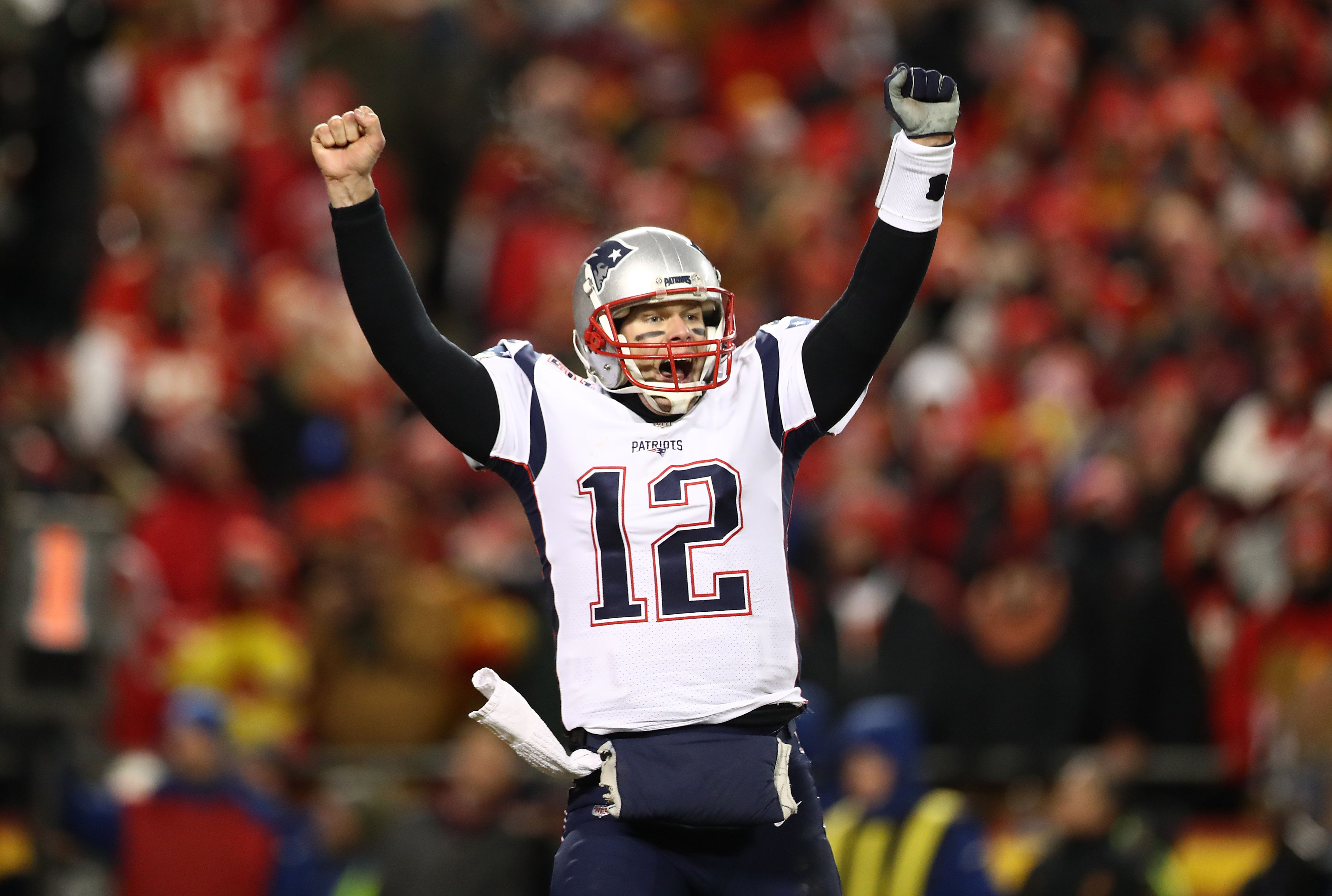 KANSAS CITY, MISSOURI - JANUARY 20: Tom Brady #12 of the New England Patriots celebrates after defeating the Kansas City Chiefs in overtime during the AFC Championship Game at Arrowhead Stadium on January 20, 2019 in Kansas City, Missouri. The Patriots defeated the Chiefs 37-31. (Photo by Ronald Martinez/Getty Images)