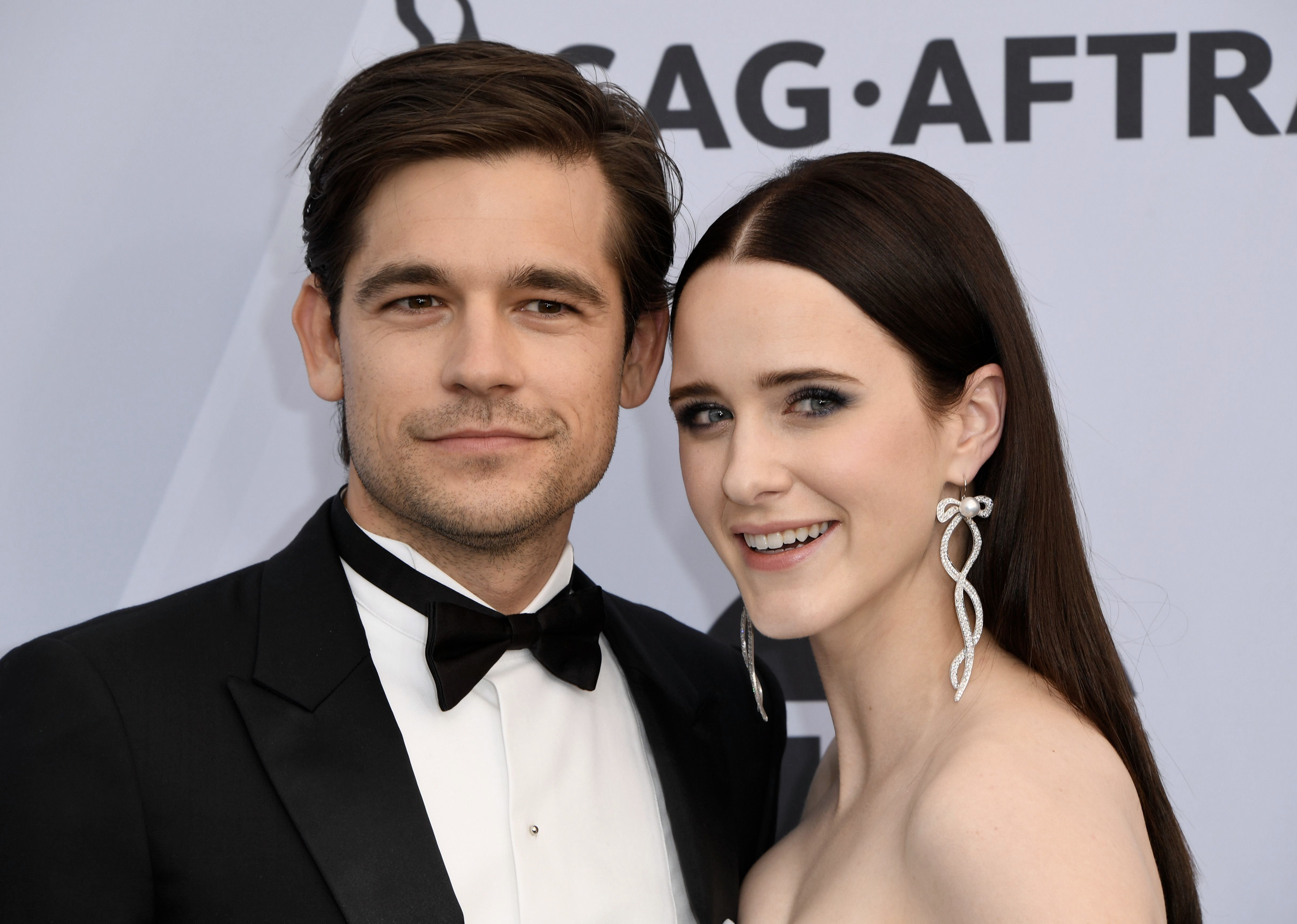 Outstanding Performance by a Female Actor in a Comedy Series for 'The Marvelous Mrs. Maisel' nominee Rachel Brosnahan and Jason Ralph arrive for the 25th Annual Screen Actors Guild Awards at the Shrine Auditorium in Los Angeles on January 27, 2019. (Photo by Mark RALSTON / AFP)        (Photo credit should read MARK RALSTON/AFP/Getty Images)