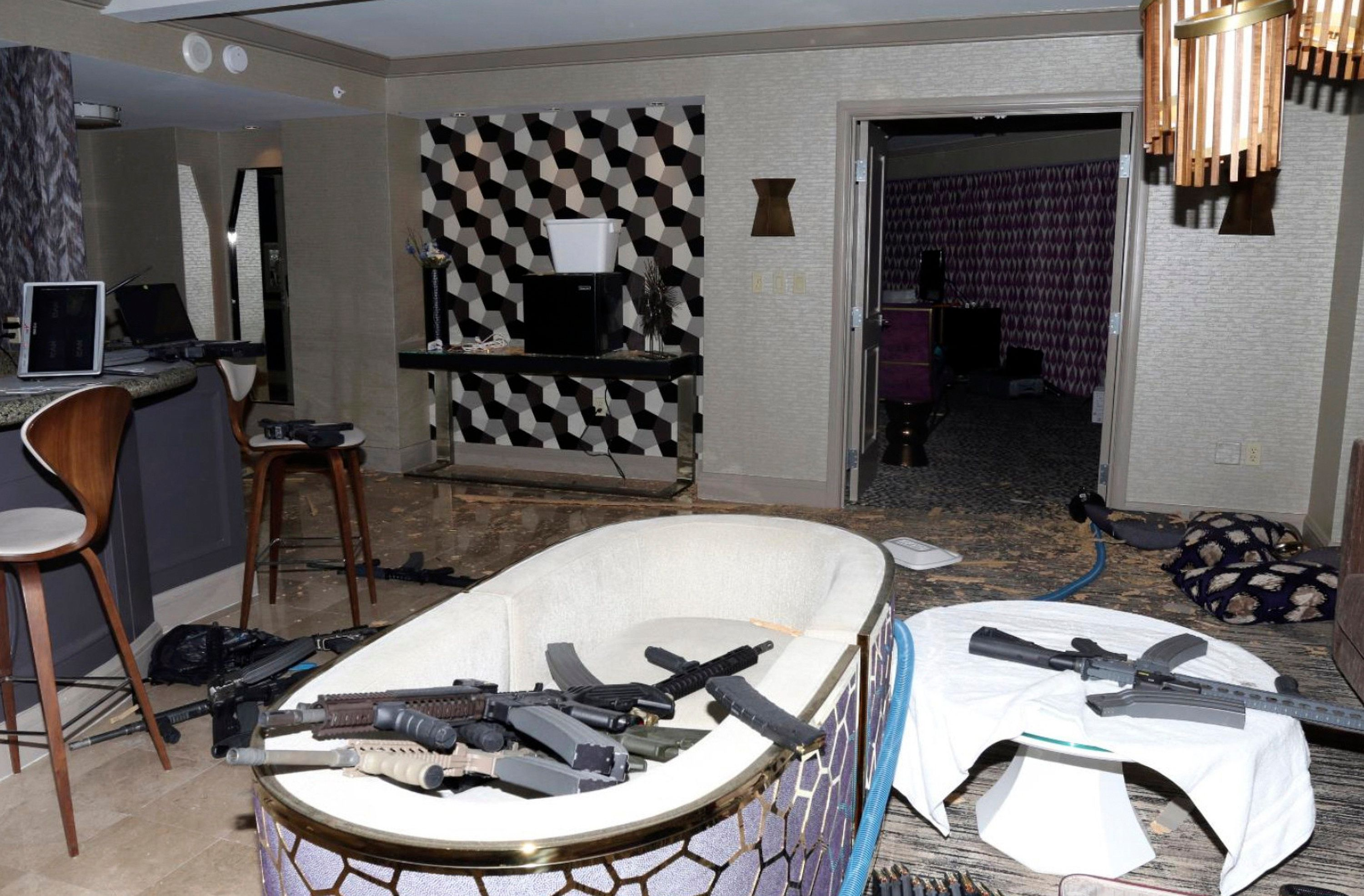 FILE - This October 2017 file evidence photo released by the Las Vegas Metropolitan Police Department Force Investigation Team Report shows the interior of Stephen Paddock's 32nd floor room of the Mandalay Bay hotel in Las Vegas after the Oct. 1, 2017 mass shooting. Police in Las Vegas said Thursday, Jan. 3, 2019, they have finished releasing audio, video and written records about the investigation of the deadliest mass shooting in modern U.S. history. (Las Vegas Metropolitan Police Department via AP, File)