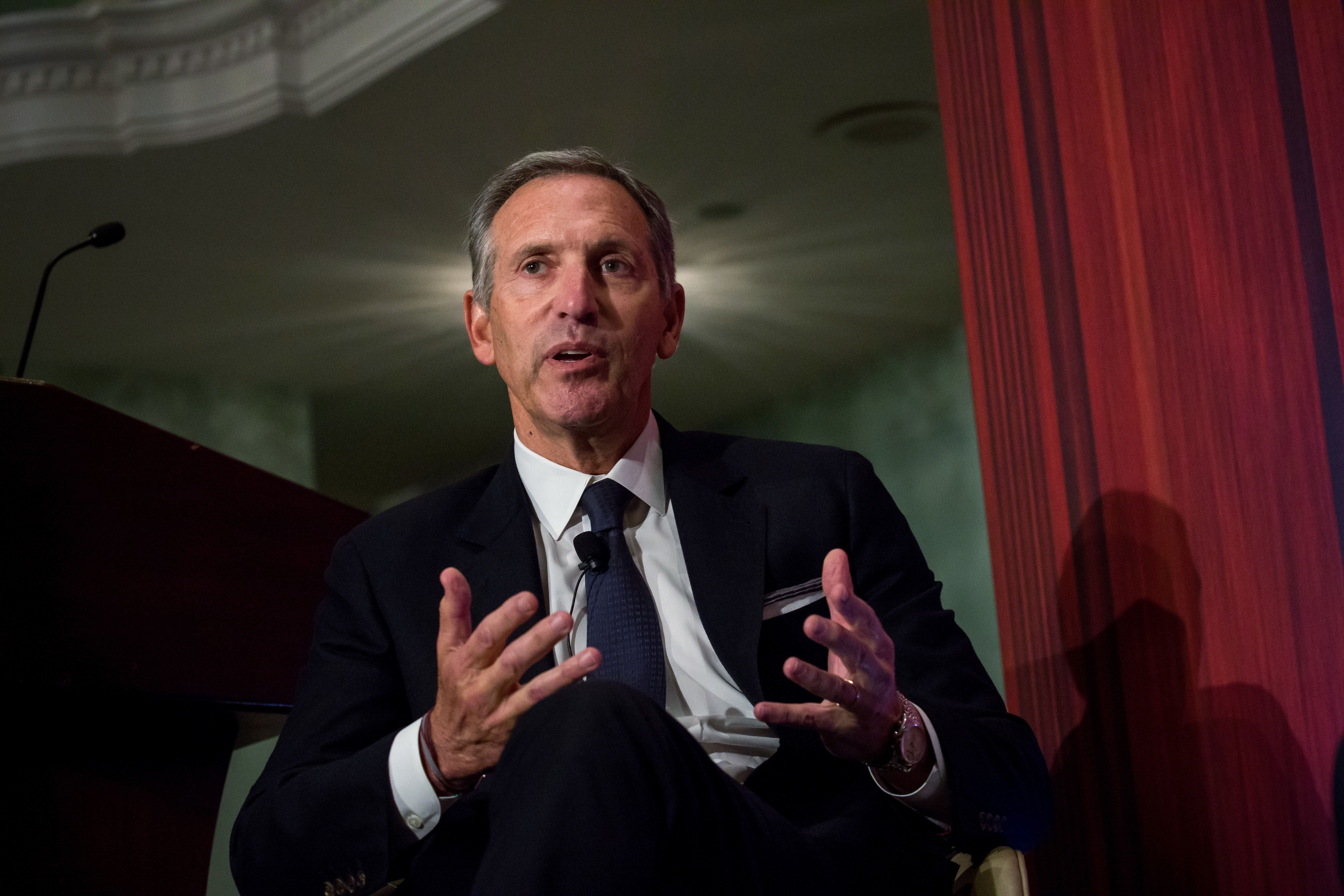 Howard Schultz, chairman and founder of Starbucks Corp., speaks during a conference at the Economic Club of New York in New York, U.S., on Wednesday, May 24, 2017. Schultz said the company has taken stances on political issues such as race and gun violence because it has a social responsibility. Photographer: Michael Nagle/Bloomberg via Getty Images