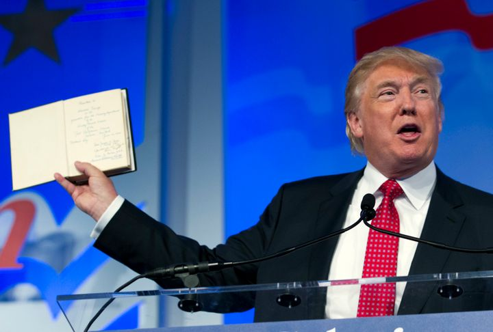 Trump holds up a Bible that was given to him by his mother as he speaks at the Values Voter Summit on Sept. 25, 2015.