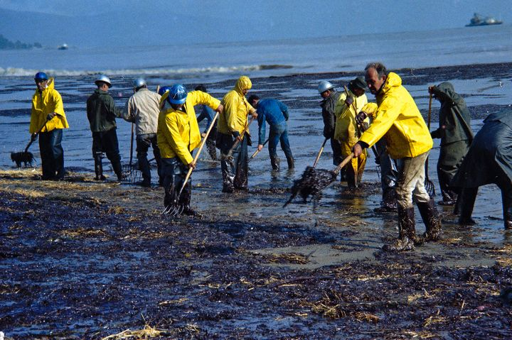 In this Feb. 6, 1969, file photo, state forestry conservation crews gather up oil-soaked straw on a beach in Santa Barbara.
