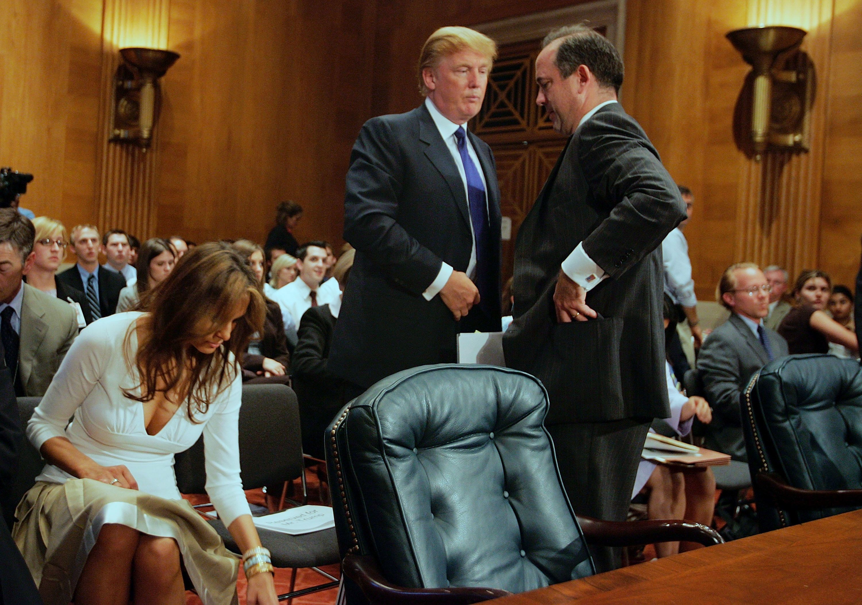 WASHINGTON - JULY 21:  Donald Trump (L), president of the Trump Organization, talks to Christopher Burnham (R), undersecretary general of the Department of Management at the United Nations, after Trump testified before the Federal Financial Management, Government Information, and International Security Subcommittee Capitol Hill July 21, 2005 in Washington, DC. Trump's wife Melania Trump is seated at left. The hearing was held on the topic of 'U.S. Financial Involvement in Renovation of UN Headquarters.'  (Photo by Joe Raedle/Getty Images)