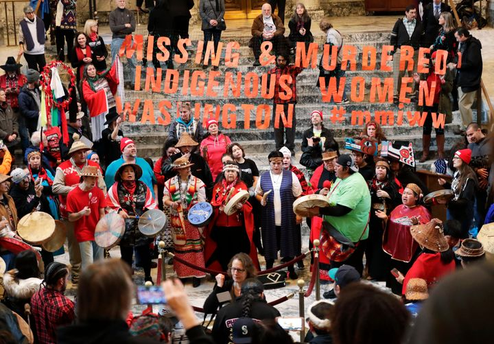 Native American tribal members sing and drum in the rotunda of the Capitol in Olympia, Washington, in January 2018. Thei