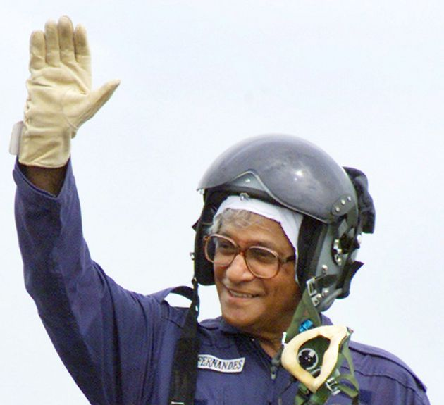 George Fernandes waves from the cockpit of a Russian-made MiG-21 fighter jet after riding it at Ambala...