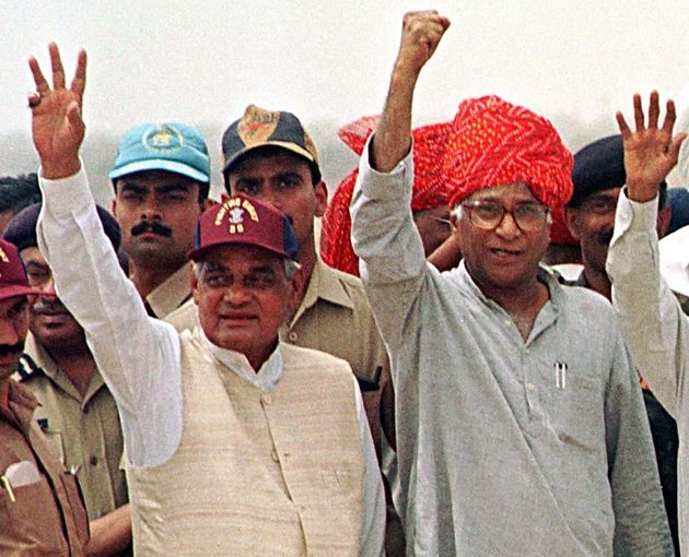 Then Prime Minister Atal Behari Vajpayee and Defence Minister George Fernandes wave at soldiers at the...