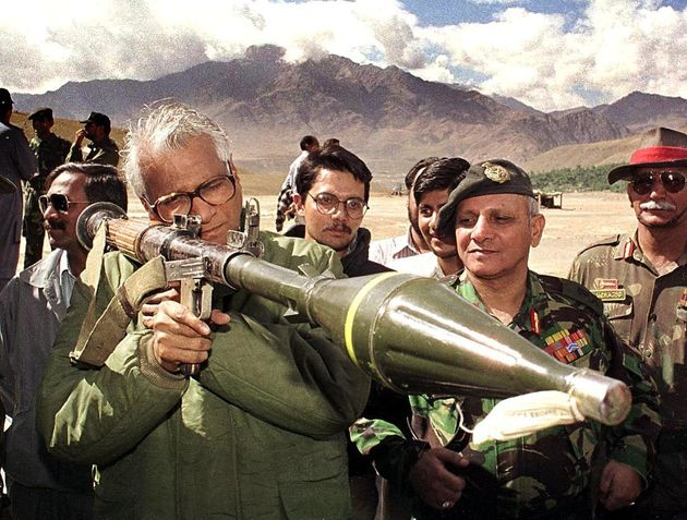 George Fernandes takes aim through a shoulder held grenade launcher which was confiscated from the posts...