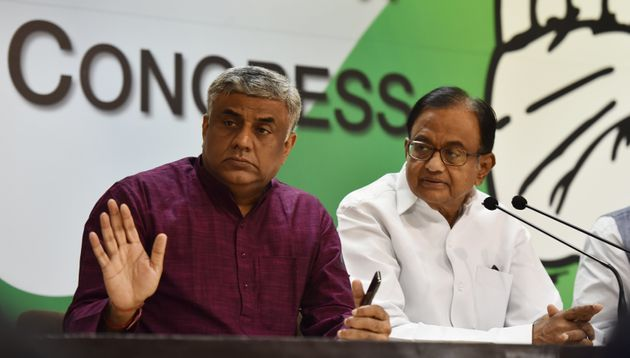 Gowda (left) with P. Chidambaram, head of the Congress's manifesto committee and former finance