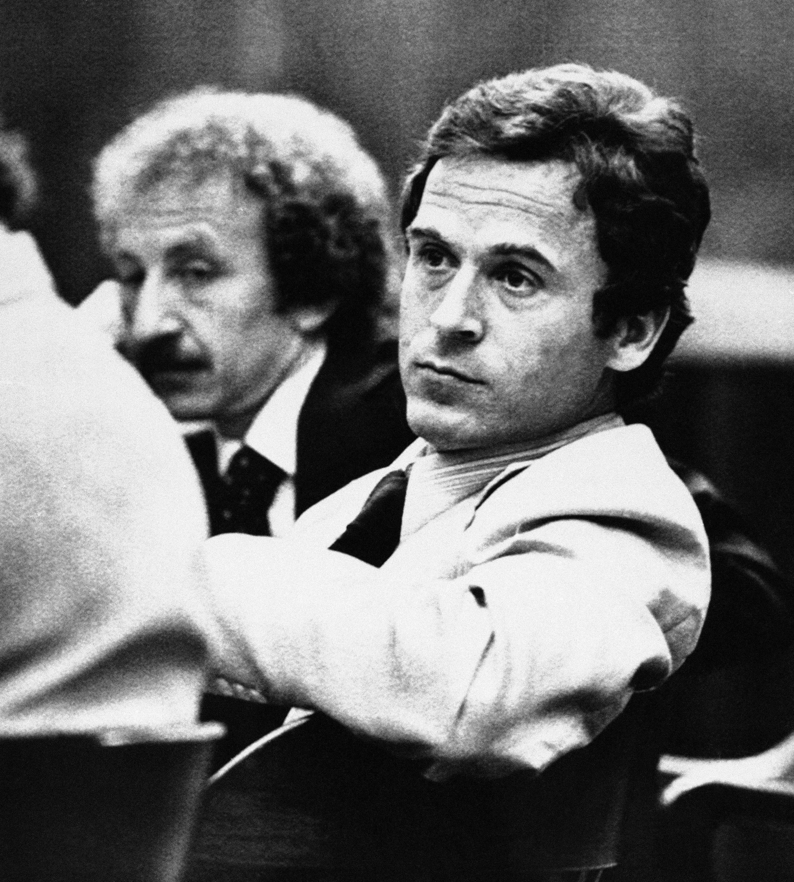 FILE - In this April 26, 1979, file photo, Ted Bundy leans back in his chair in the courtroom before his trial in Tallahassee, Fla. One of the most notorious serial killers in American history, Bundy is believed to have killed at least 30 young women across the United States in the 1970s. Bundy was one of the hundreds of fugitives who have appeared on the FBI's Ten Most Wanted Fugitives list. (AP Photo/Mark Foley, File)