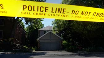 FILE PHOTO: Police investigate a home that accused serial killer Bruce McArthur worked at in Toronto, Ontario, Canada, July 6, 2018.  REUTERS/Carlo Allegri/File Photo