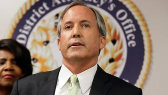 FILE - In this June 22, 2017 file photo, Texas Attorney General Ken Paxton speaks at a news conference in Dallas. Paxton has raised more than $500,000 to pay for private attorneys who are defending him on criminal securities fraud charges. Financial statements released Wednesday, July 5, 2017, show that the Republican last year received donations for his legal bills not just from Texas but from individuals and groups in Arizona, Arkansas and Virginia. (AP Photo/Tony Gutierrez, File)