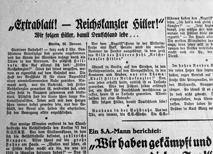An archival photo shows the front page of a newspaper from Jan. 31, 1933, reporting the formation of the new German Cabinet w