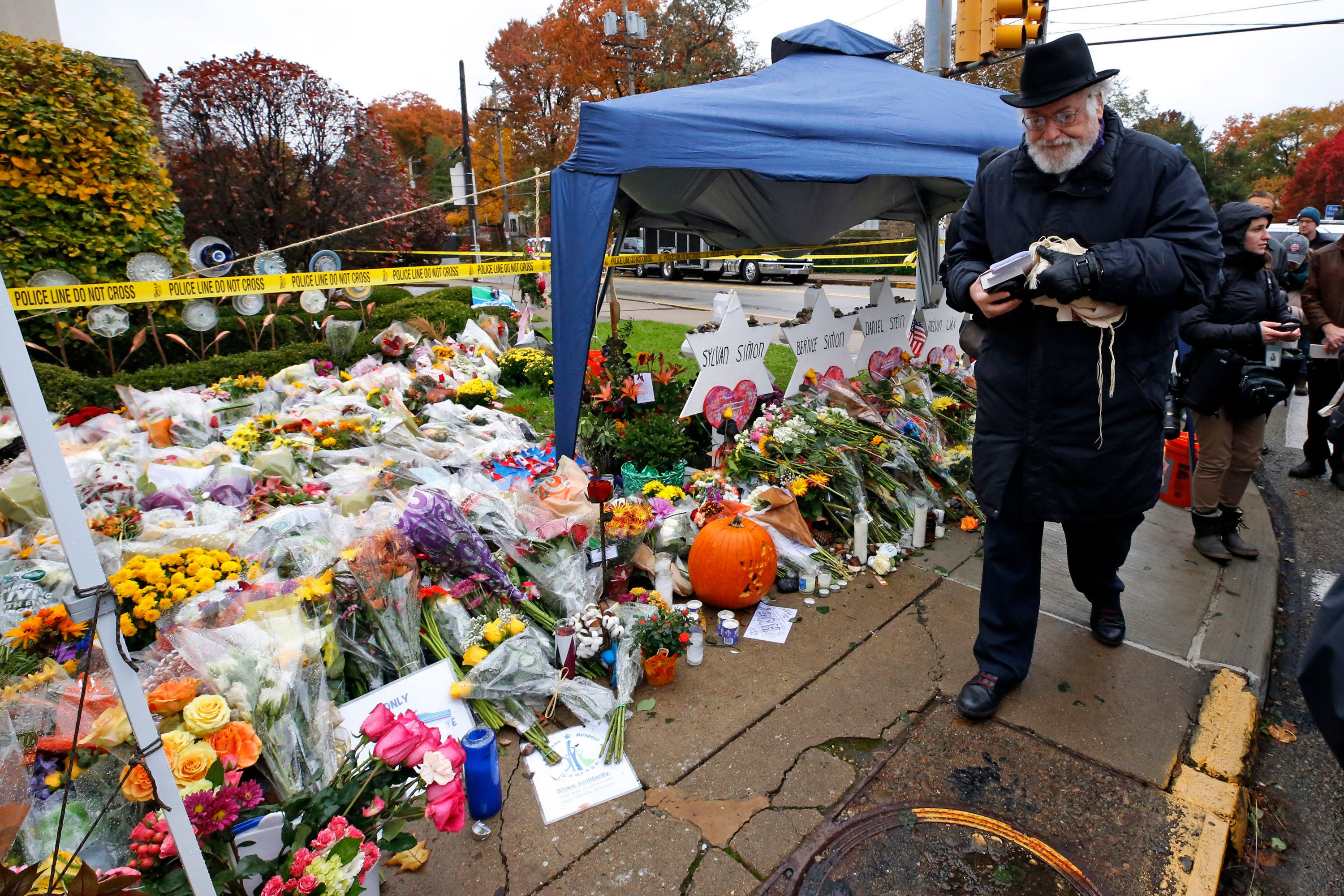 Rabbi Chuck Diamond arrives on the street corner outside the Tree of Life Synagogue on Nov. 3, 2018, to lead a Shabbat morning service one week after 11 people were killed and six wounded in a shooting at the synagogue.