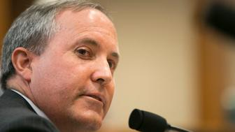 July 29th, 2015 Austin, Texas USA: Texas Attorney General Ken Paxton testifies in front of the Senate Committee on Health and Human Services, just a few days before a grand jury indicts him on three felonies.Two charges of first-degree securities fraud and one count of third-degree failure to register. Paxton is expected to surrender on August 3rd, 2015 (Photo by Robert Daemmrich Photography Inc/Corbis via Getty Images)