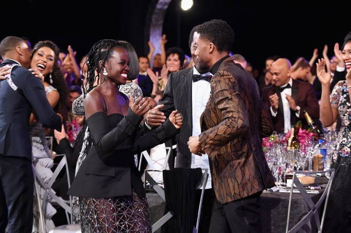 "Nyong'o and Chadwick Boseman (right) after the ""Black Panther"" cast prize was announced at the SAG Awards."
