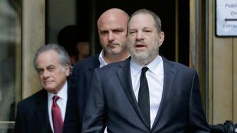 Harvey Weinstein, right, leaves New York Supreme Court, Friday, Jan. 25, 2019, in New York. A judge signed off Friday on changes to the legal team representing Weinstein in his rape and sexual assault case, allowing the film producer to swap out his bulldog New York City defense attorney for a four-person team that's full of courtroom star power. (AP Photo/Julio Cortez)