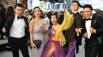 (From L) Members of the cast of 'Crazy Rich Asians' Ronny Chieng, Tan Kheng Hua, Fiona Xie, Harry Shum Jr. and director Jon M. Chu walk the red carpet at the 25th Annual Screen Actors Guild Awards at the Shrine Auditorium in Los Angeles on January 27, 2019. (Photo by Robyn Beck / AFP)        (Photo credit should read ROBYN BECK/AFP/Getty Images)