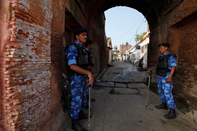Security personnel guard outside a temple in Ayodhya, Aug. 25,