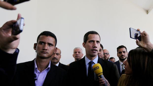 Opposition National Assembly President Juan Guaido, who declared himself interim president of Venezuela, speaks with the media upon his arrival to National Assembly in Caracas, Venezuela, Tuesday, Jan. 29, 2019. Venezuela's chief prosecutor on Tuesday asked the country's top court to ban Guaido from leaving the country, launching a criminal probe into his anti-government activities while international pressure builds against President Nicolas Maduro. (AP Photo/Fernando Llano)