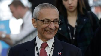 John Podesta, campaign chairman for Democratic presidential candidate Hillary Clinton, walks through the Jacob Javits Center in New York, Tuesday, Nov. 8, 2016, before Clinton's election night rally. (AP Photo/Matt Rourke)