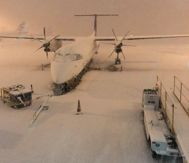 Heavy snow covered planes at Manchester Airport on Wednesday as passengers reported