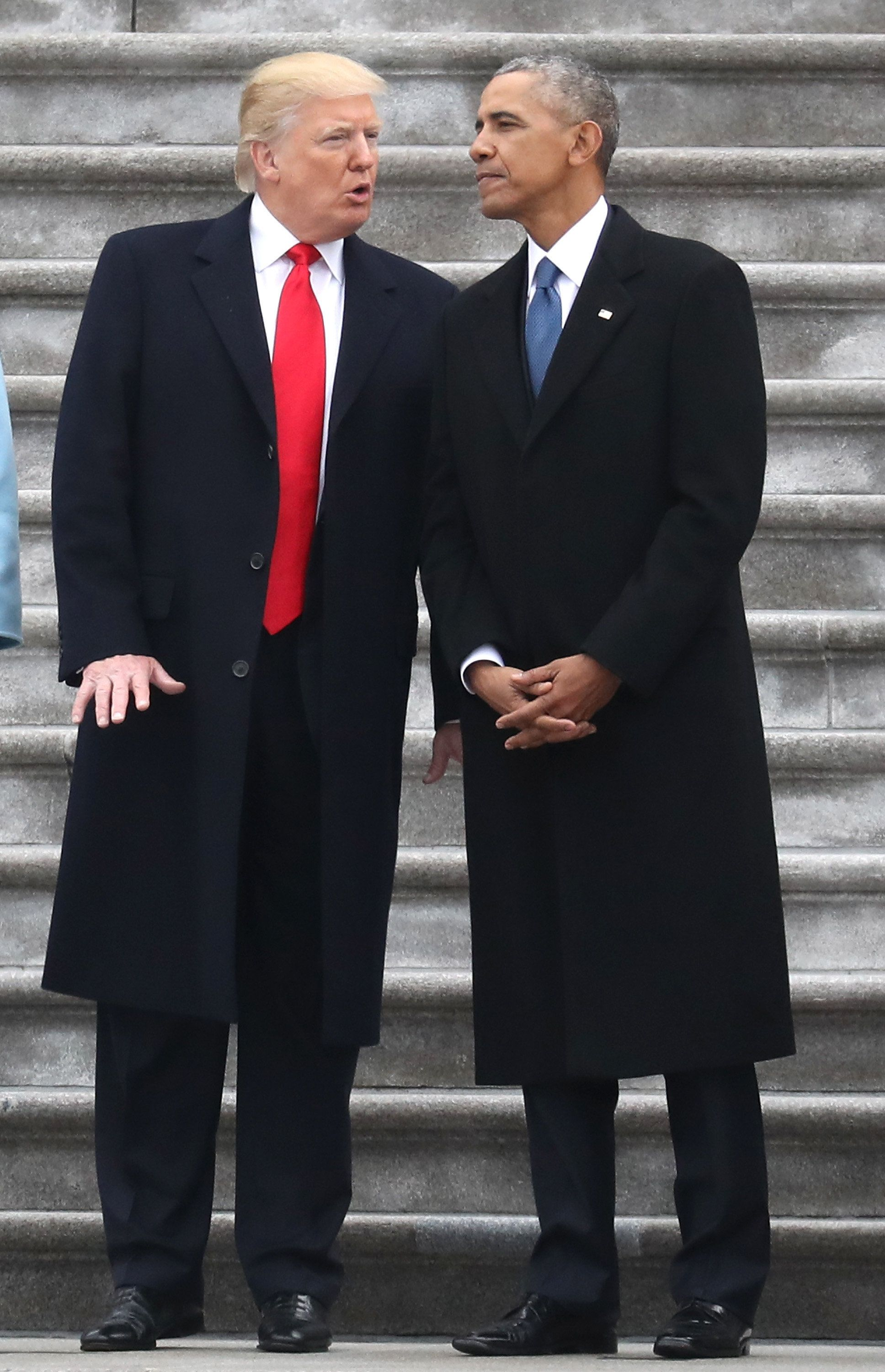 WASHINGTON, DC - JANUARY 20:  President Donald Trump and former president Barack Obama exchange words at the  U.S. Capitol  on January 20, 2017 in Washington, DC. In today's inauguration ceremony Donald J. Trump becomes the 45th president of the United States.  (Photo by Rob Carr/Getty Images)