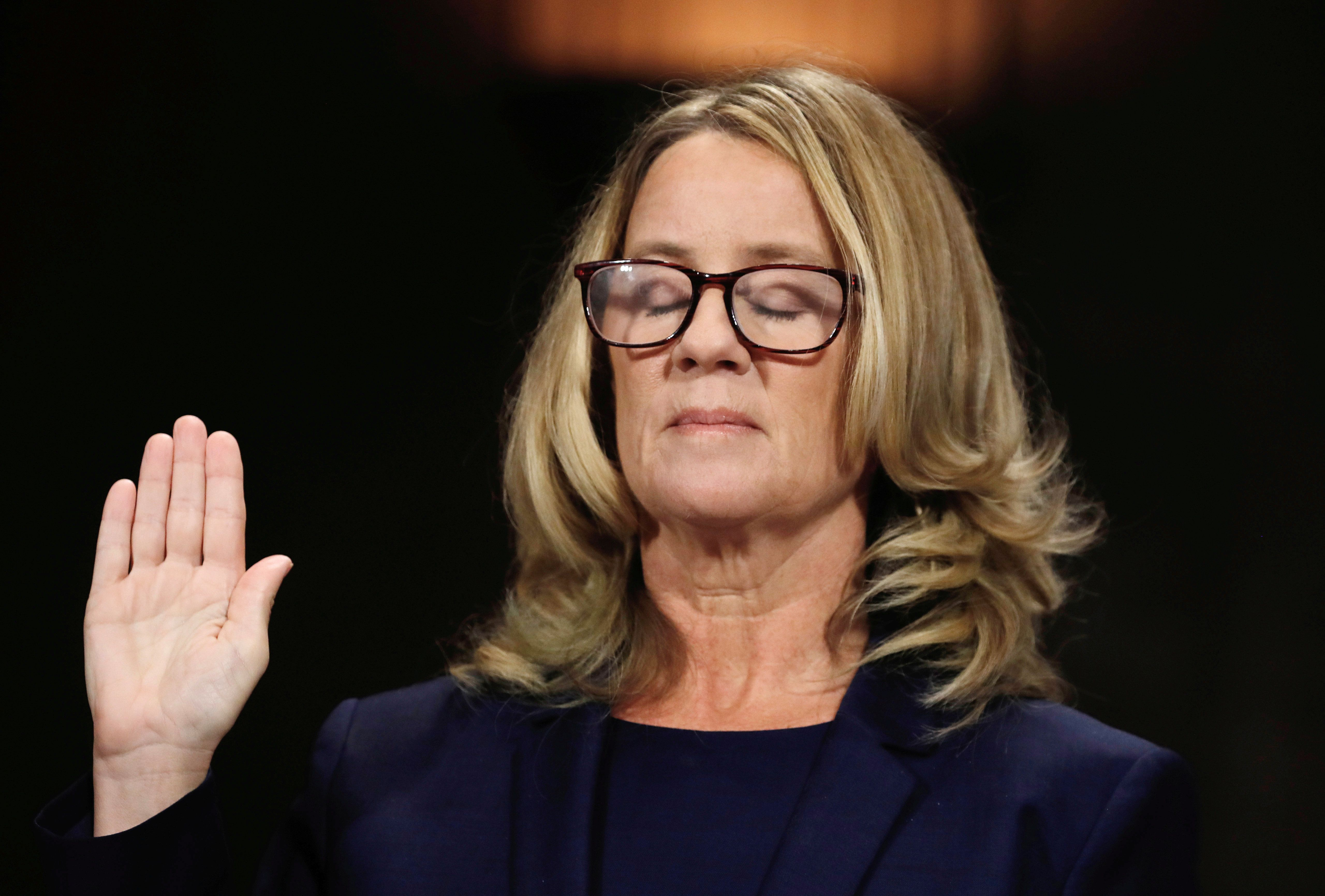 Christine Blasey Ford is sworn in to testify before the Senate Judiciary Committee on Capitol Hill in September. Rep. Jackie