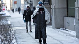 A pedestrian walks in downtown Chicago, Illinois, U.S., on Wednesday, Jan. 30, 2019. Bitter cold is taking hold across the upper Midwest to the Northeast, prompting warnings to stay indoors. The National Weather service said the temperature in Chicago dropped on Wednesday morning to minus 19 degrees, breaking the previous record low for the day set in 1966. Photographer: Daniel Acker/Bloomberg via Getty Images