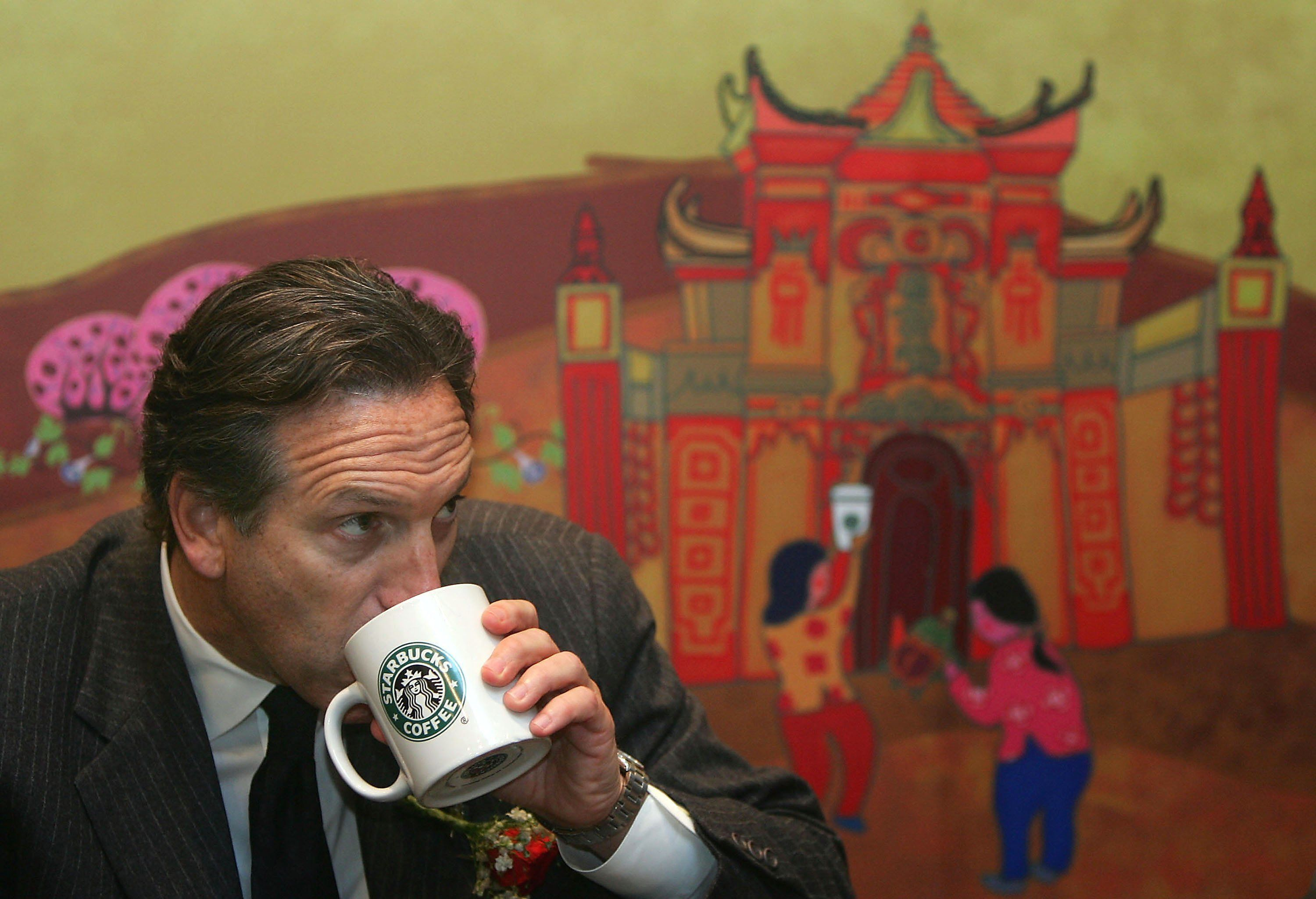 CHONGQING, CHINA - FEBRUARY 16: (CHINA OUT) Howard Schultz, president of the US Starbucks coffee chain, drinks a cup of coffee in the first Starbucks store on February 16, 2006 in Chongqing Municipality, China. Starbucks is taking the plunge into the Chongqing market. The Chinese coffee market is expected to grow by 70 per cent in total sales volume between 2003 and 2008 to reach 11,073 tons, Euromonitor's findings indicate. (Photo by China Photos/Getty Images)