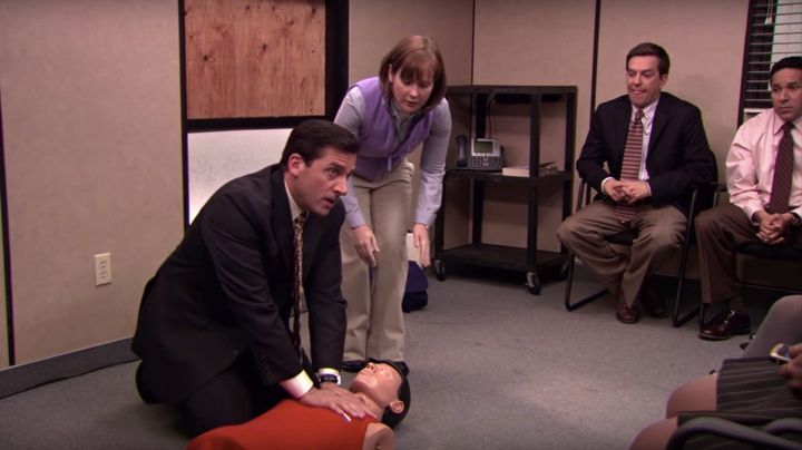 "Michael Scott (Steve Carell) practices CPR on a dummy in a 2009 episode of ""The Office."""