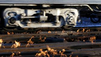 A Metra train moves southbound to downtown Chicago as the gas-fired switch heater on the rails keeps the ice and snow off the switches near Metra Western Avenue station in Chicago, Tuesday, Jan. 29, 2019. Forecasters warn that the freezing weather Tuesday will get worse and could be life-threatening. (AP Photo/Kiichiro Sato)