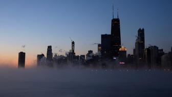 Steam rises up on the surface of Lake Michigan, Wednesday, Jan. 30, 2019, in Chicago. A deadly arctic deep freeze enveloped the Midwest with record-breaking temperatures on Wednesday, triggering widespread closures of schools and businesses, and prompting the U.S. Postal Service to take the rare step of suspending mail delivery to a wide swath of the region. (AP Photo/Kiichiro Sato)