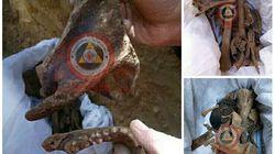 Exhumation des restes des corps d'une vingtaine de martyrs à