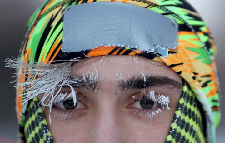Frost covers part of the face of University of Minnesota student Daniel Dylla during a morning jog along Mississippi River Pa