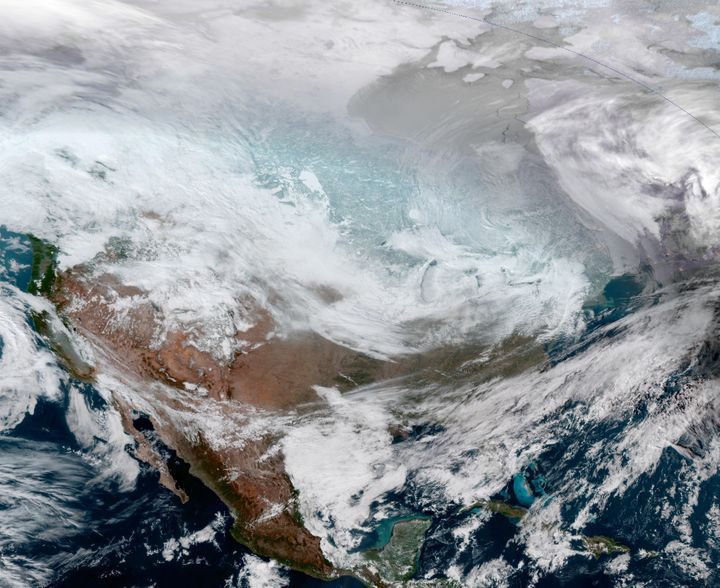 A satellite image of the continental United States shows the extreme cold weather phenomenon called the polar vortex over the