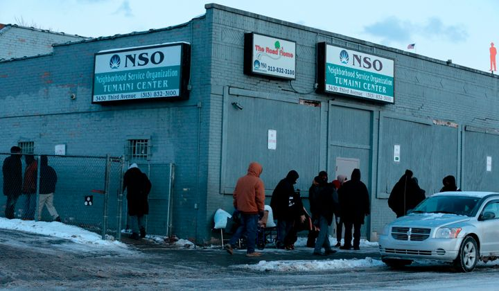 People gather in the cold weather outside of Neighborhood Service Organization on Third Ave. in Detroit, Michigan on Jan. 29,