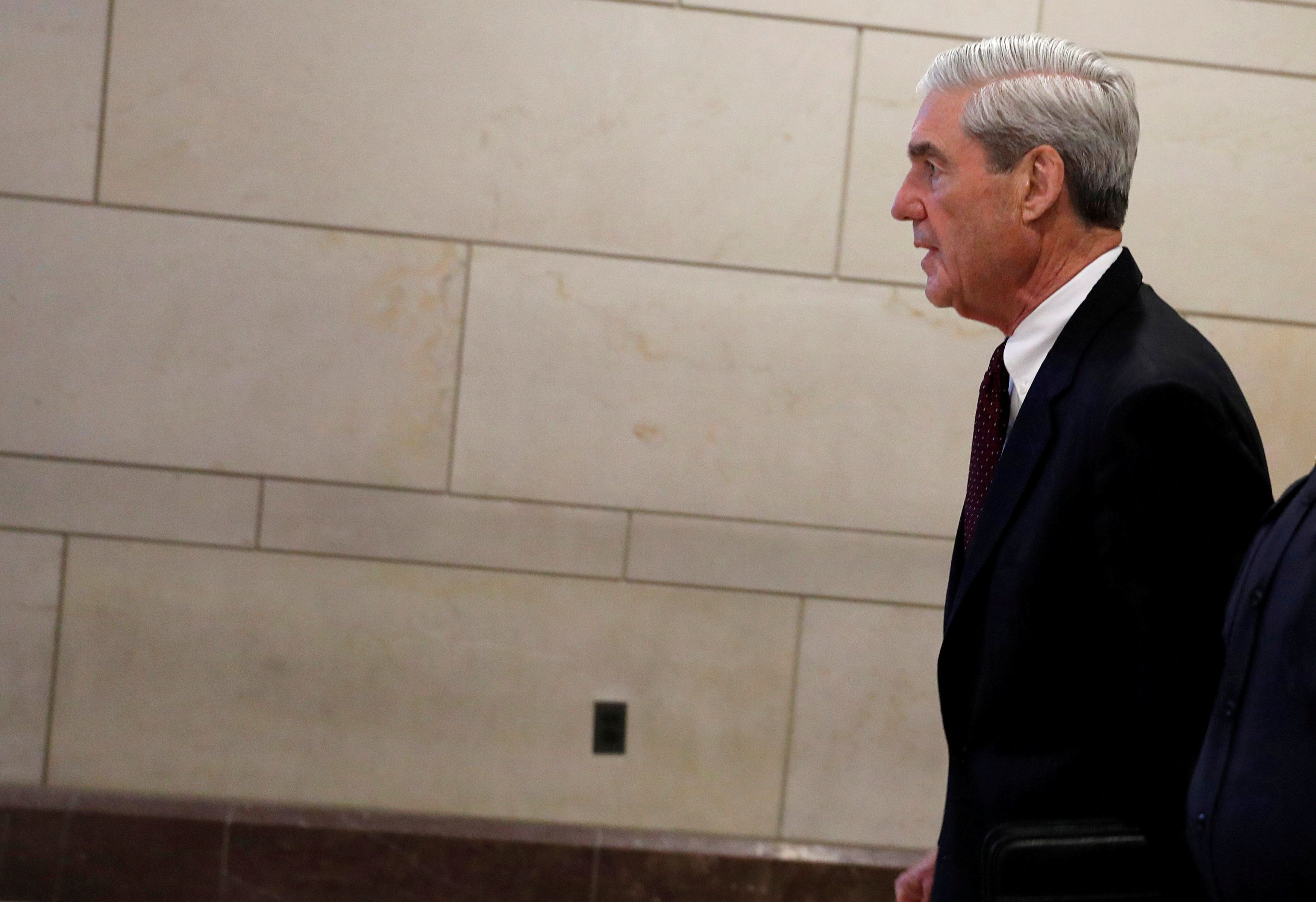 FILE PHOTO: Special Counsel Robert Mueller departs after briefing the U.S. House Intelligence Committee on his investigation of potential collusion between Russia and the Trump campaign on Capitol Hill in Washington, U.S., June 20, 2017. REUTERS/Aaron P. Bernstein/File Photo