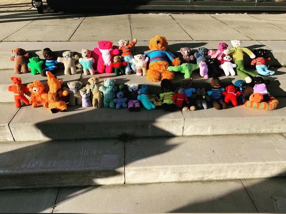 Locals put teddy bears outside of the Legacy Hub during a protest on Sunday to represent the number of...