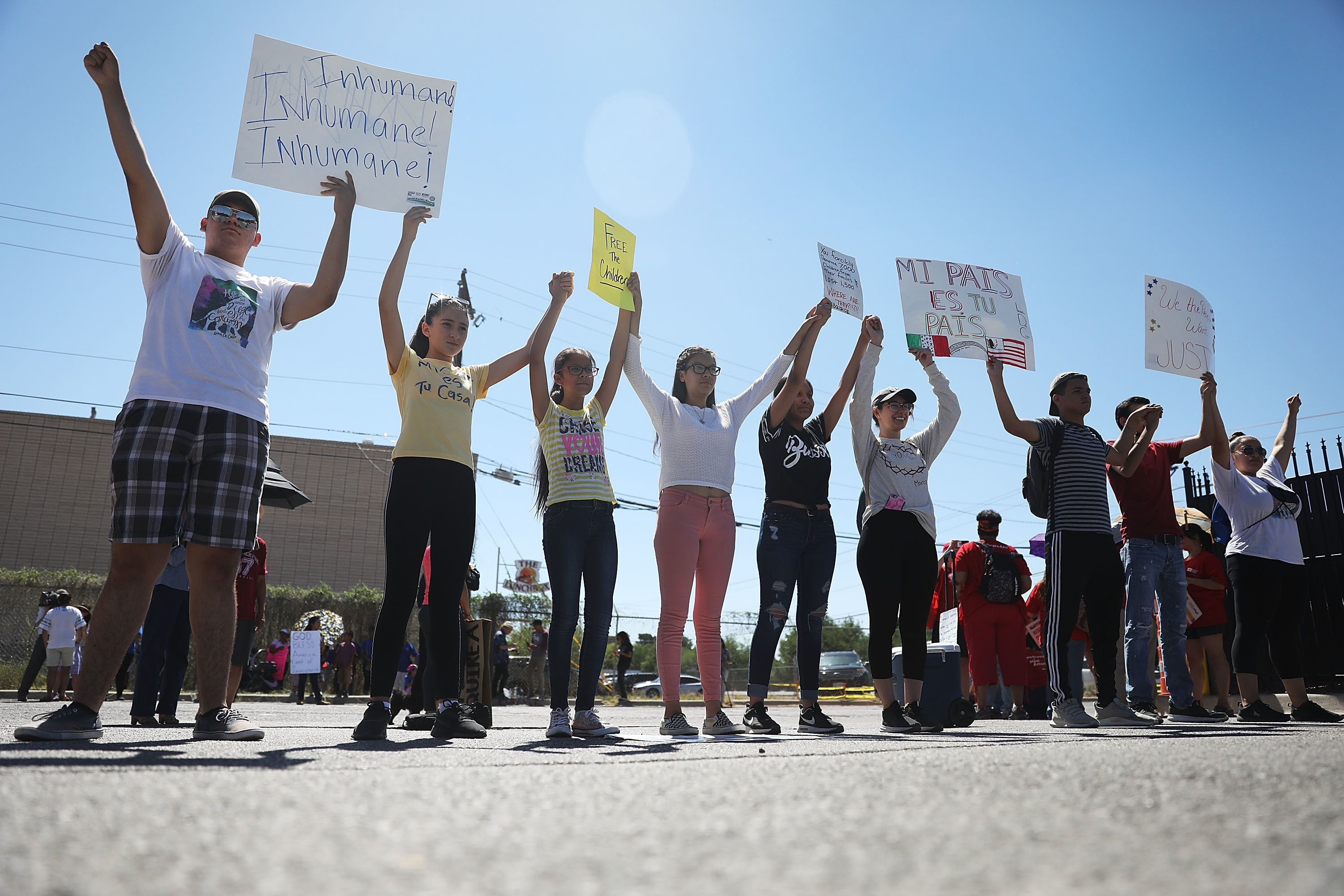 EL PASO, TX - JUNE 19:  People protest the separation of children from their parents in front of the El Paso Processing Center, an immigration detention facility, at the Mexican border on June 19, 2018 in El Paso, Texas. The separations have received intense scrutiny as the Trump administration institutes a zero tolerance policy on illegal immigration.  (Photo by Joe Raedle/Getty Images)